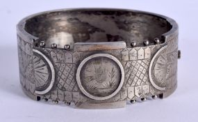 A VICTORIAN AESTHETIC MOVEMENT WHITE METAL BANGLE. 22 grams. 6 cm wide.