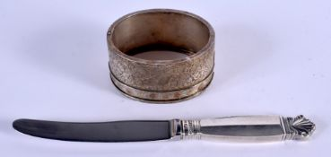 A GEORG JENSEN SILVER HANDLED KNIFE and a white metal bangle. 55 grams. (2)