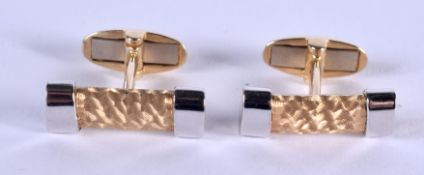 A PAIR OF TWO TONE 14CT GOLD CUFFLINKS. 10.8 grams.