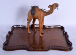 A 1920S CARVED MAHOGANY CHIPPENDALE SERVING TRAY together with a leather camel. Largest 55 cm x 37 c