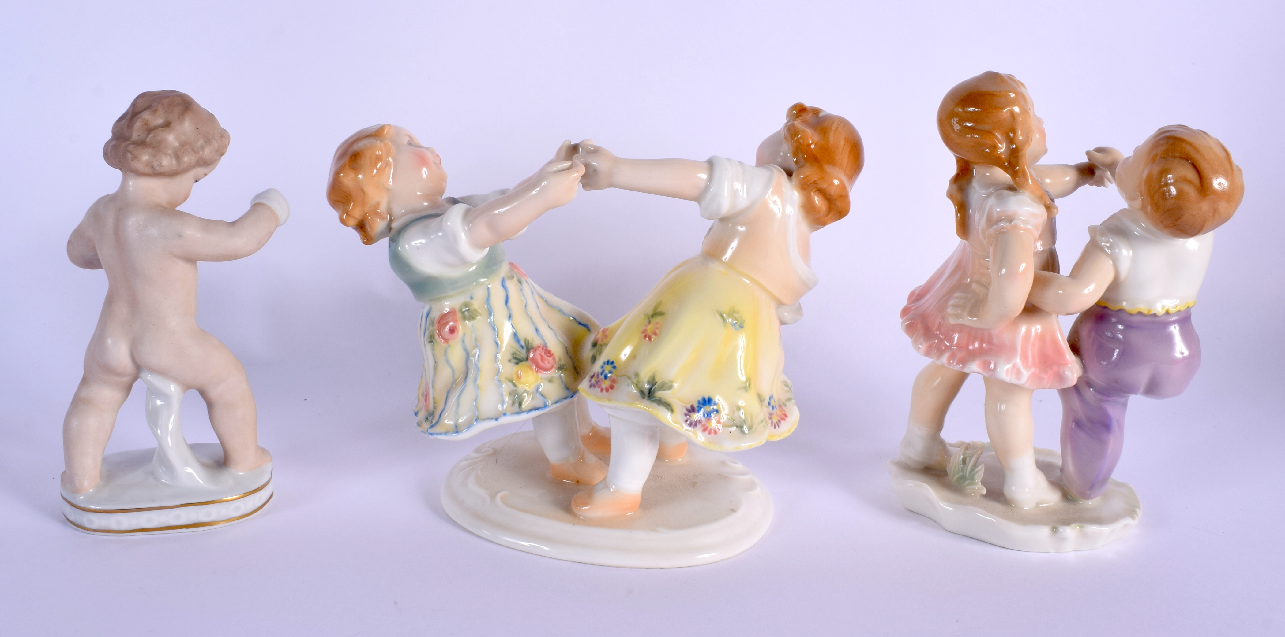 TWO KARL ENZ VOLKSTEDT PORCELAIN FIGURAL GROUPS together with another similar. Largest 14 cm x 14 cm - Image 2 of 3