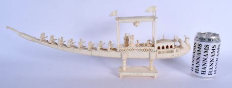 A 19TH CENTURY ANGLO INDIAN CARVED IVORY PROCESSIONAL BOAT decorated with figures and foliage. 45 cm