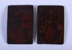 TWO FINE 19TH CENTURY PERSIAN QAJAR LACQUERED PANELS painted with figures. Each 6 cm x 4.25 cm. (2)