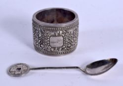 AN ANTIQUE SILVER NAPKIN RING and silver spoon. 53 grams. (2)