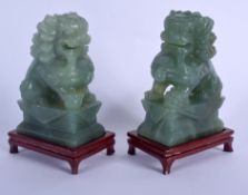 A PAIR OF EARLY 20TH CENTURY CHINESE CARVED JADE FIGURES OF LIONS Late Qing/Republic. Jade 12 cm x 6