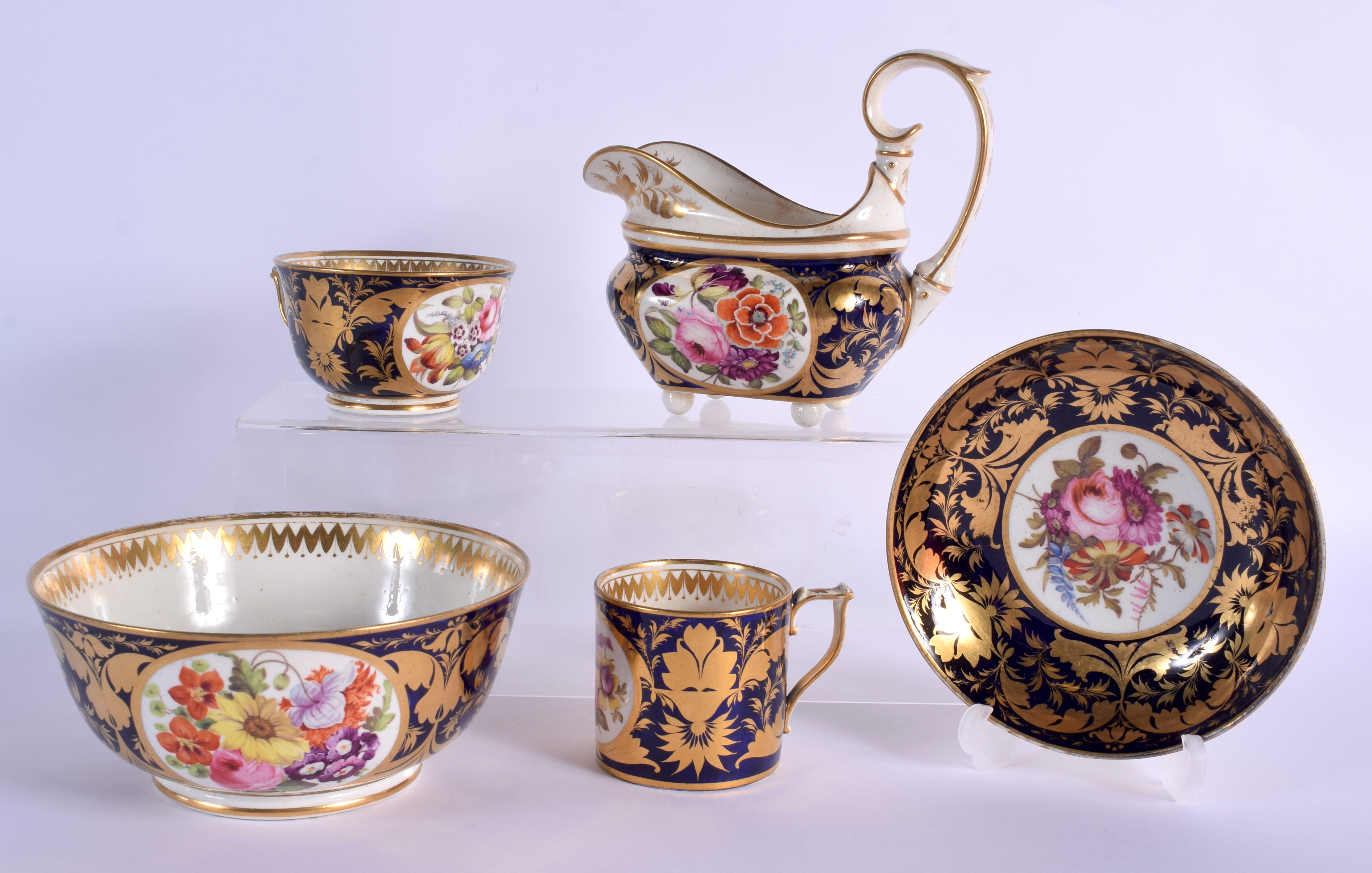 AN EARLY 19TH DERBY PORCELAIN TEAWARES including a trio, cream jug and slop bowl. Largest 12 cm diam