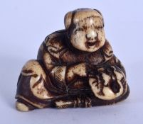 A 19TH CENTURY JAPANESE MEIJI PERIOD CARVED STAG ANTLER NETSUKE in the manner of Ishikawa Rensai. 3