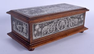 A FINE 19TH CENTURY ANGLO INDIAN SILVERED STEEL AND HARDWOOD CASKET decorated with elephants and lan