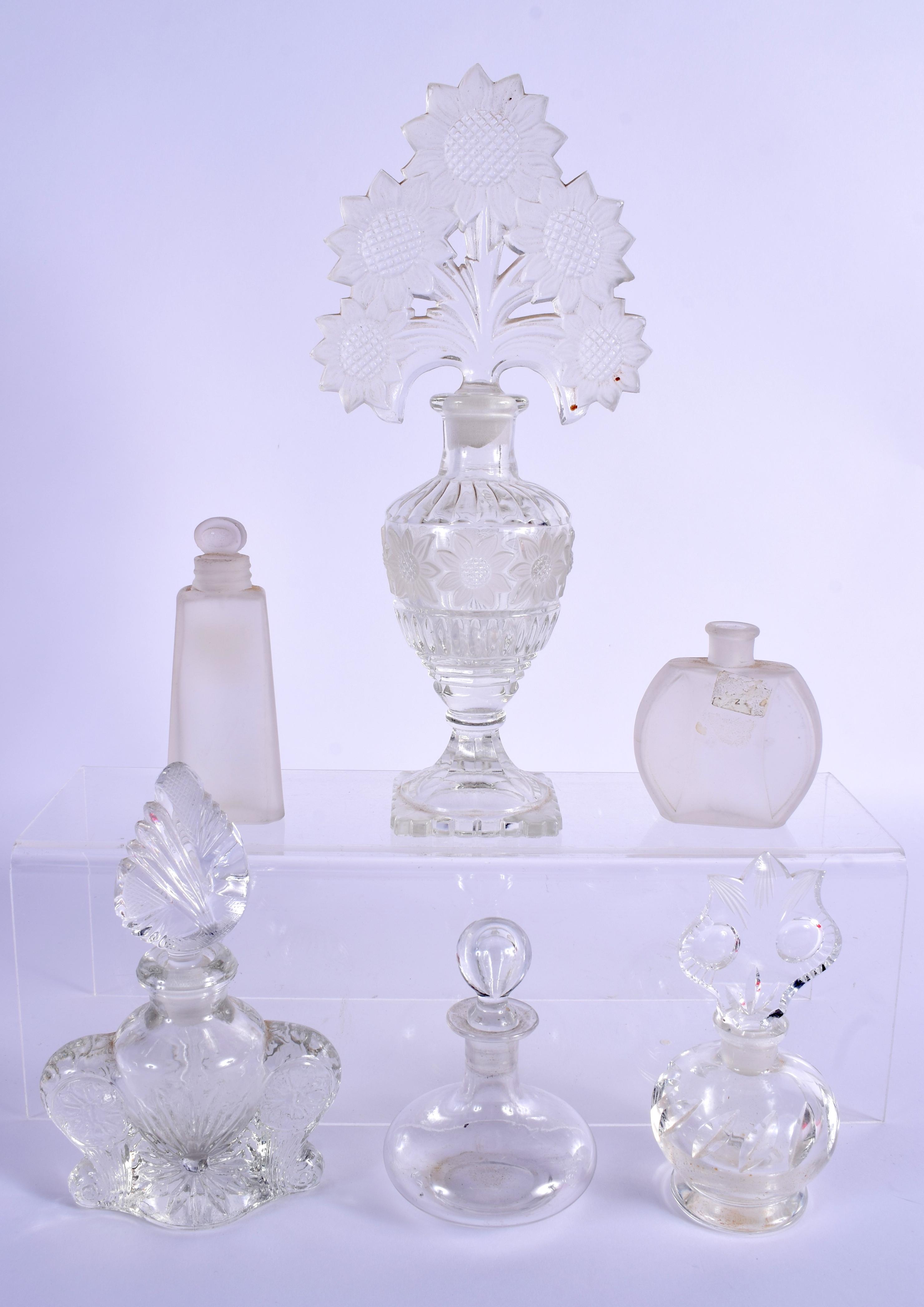 SIX ART DECO GLASS SCENT BOTTLES. Largest 15 cm high. (6)