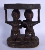AN UNUSUAL AFRICAN CARVED TRIBAL YORUBA STOOL formed as male and female beside each other. 36 cm x 3