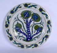 A MIDDLE EASTERN TURKISH FAIENCE IZNIK POTTERY PLATE painted with green and blue foliage. 33 cm diam