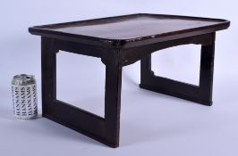 AN EARLY 20TH CENTURY CHINESE KOREAN SOFTWOOD LOW TABLE of small proportions. 26 cm x 42 cm.