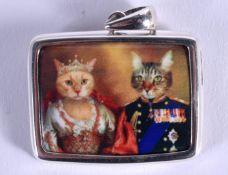 A SILVER CAT PENDANT. 3 cm x 2 cm.