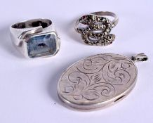 TWO VINTAGE SILVER RINGS and a 1970S silver locket. 27 grams. (3)
