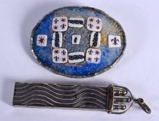 A SOUTHERN EUROPEAN SILVER MOUNTED BROOCH and a pen holder. (2)