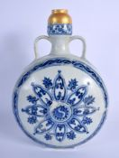 A CHINESE QING DYNASTY TWIN HANDLED BLUE AND WHITE PILGRIM FLASK painted with buddhistic emblems an