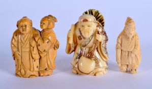 A 19TH CENTURY JAPANESE MEIJI PERIOD CARVED IVORY NETSUKE together with two others. Largest 5.5 cm x