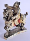 A 19TH CENTURY CHINESE CARVED PAINTED IVORY FIGURE OF A HORSE modelled with an attendant. 11 cm x 12