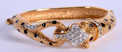A CARTIER STYLE COSTUME BANGLE. 6.5 cm wide.