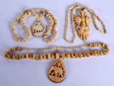 THREE CONTINENTAL ANTIQUE IVORY NECKLACES. (3)