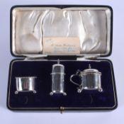 AN ART DECO SILVER CRUET SET. Birmingham 1921. Silver 68 grams. (3)