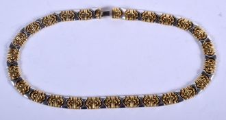 A LOVELY 18CT GOLD TWO TONE BVLGARI STYLE NECKLACE of stylish form. 57 grams. 41 cm long.