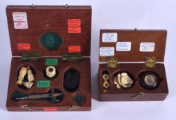 TWO LOVELY ANTIQUE MINIATURE TREEN BOXES containing miniature artefacts, including a magnifying glas