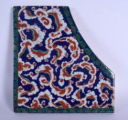 A LARGE TURKISH IZNIK FAIENCE GLAZED POTTERY FRAGMENTARY TILE painted with green and red flowers. 30