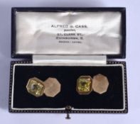 A PAIR OF ART DECO GOLD AND YELLOW STONE CUFFLINKS possibly Yellow Sapphires. 9 grams. 1.5 cm x 1.3