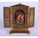 A 19TH CENTURY EUROPEAN BRONZE AND PORCELAIN ICON painted with a Madonna and child. 11 cm x 13 cm.
