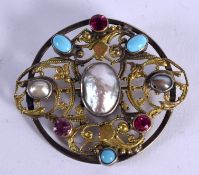A 19TH CENTURY AUSTRO HUNGARIAN BAROQUE PEARL AND RUBY BROOCH. 3.5 cm wide.
