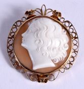 A 9CT GOLD CAMEO BROOCH carved with a pretty female. 17 grams. 5 cm x 4.5 cm.