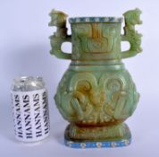 A CHINESE TWIN HANDLED JADE VASE 20th Century, with Continental silver mounts, decorated with foliag
