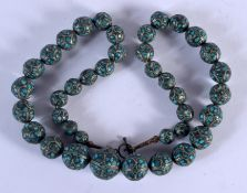 A 19TH CENTURY CONTINENTAL TURQUOISE NECKLACE. 44 cm long.
