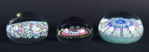 THREE VINTAGE EUROPEAN GLASS PAPERWEIGHTS. Largest 6.75 cm diameter. (3)