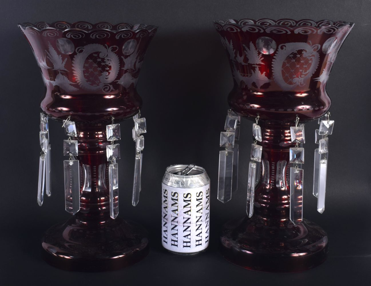 A LARGE PAIR OF VINTAGE RUBY GLASS TABLE LUSTRES decorated with landscapes. 30 cm x 18 cm.
