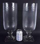 A LARGE PAIR OF CUT GLASS STORM CELERY VASES. 40 cm high.
