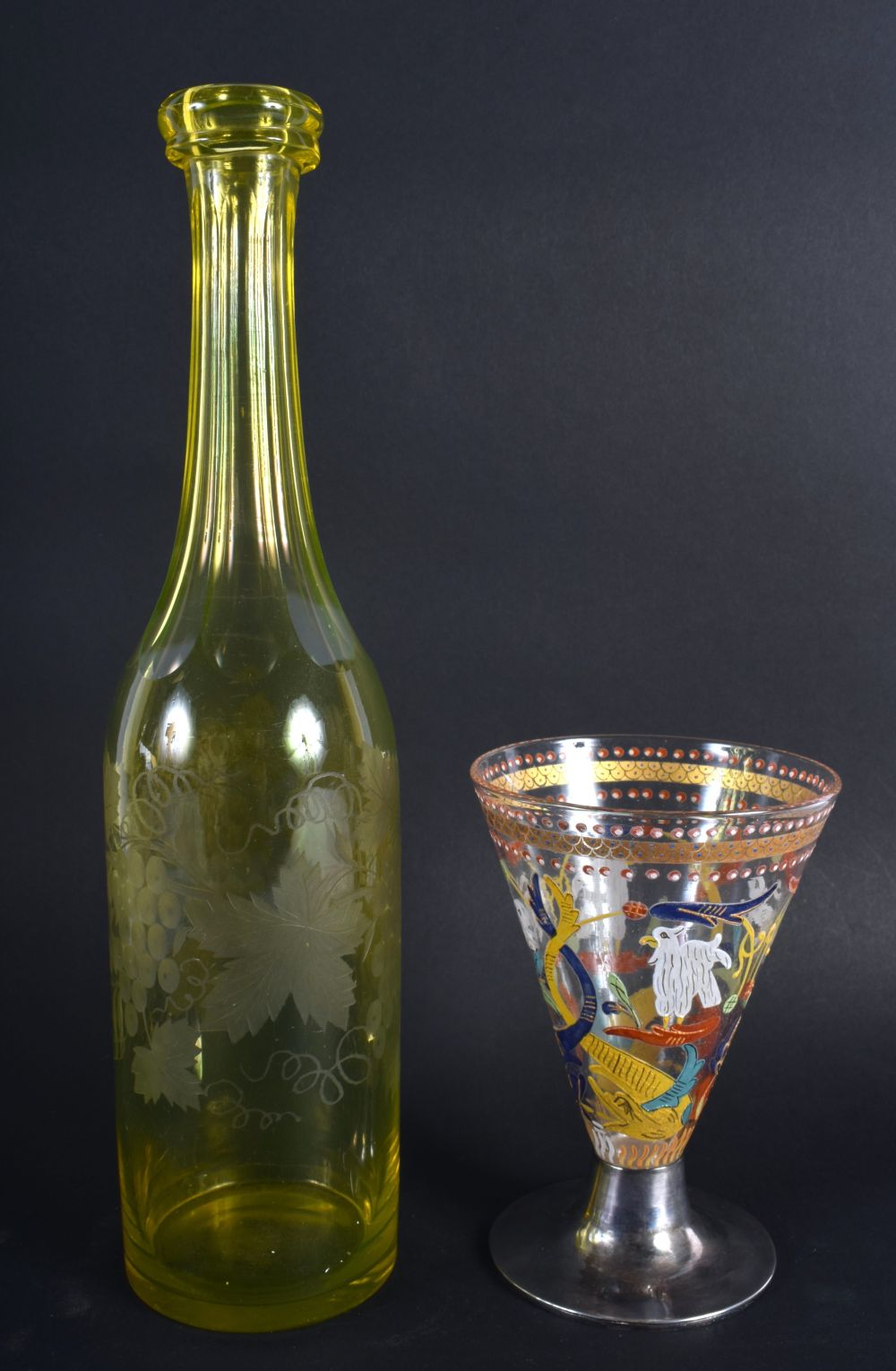 A VINTAGE YELLOW GLASS ENGRAVED DECANTER together with an early silver mounted European glass goblet