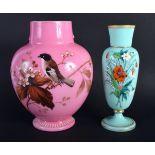 AN EDWARDIAN PINK OPALINE GLASS VASE together with a smaller vase. Largest 21 cm high. (2)