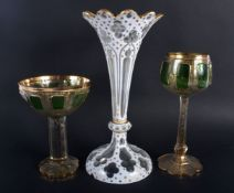 A LARGE ANTIQUE BOHEMIAN WHITE ENAMELLED GLASS VASE together with two green & gilt glasses. Largest