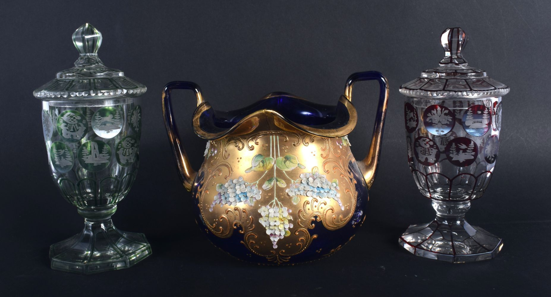 A PAIR OF BOHEMIAN GLASS CUPS AND COVERS together with a twin handled bowl. Largest 13 cm x 15 cm. ( - Image 2 of 2