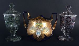 A PAIR OF BOHEMIAN GLASS CUPS AND COVERS together with a twin handled bowl. Largest 13 cm x 15 cm. (
