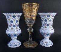 A LARGE ANTIQUE GILT OVERLAID GLASS VASE together with a pair of bohemian white enamel overlaid vase