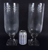 A LARGE PAIR OF CUT GLASS STORM CELERY VASES. 34 cm high.