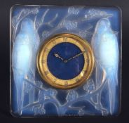 AN ART DECO FRENCH RENE LALIQUE GLASS CLOCK Designed 1926, Inseparables, moulded with birds. 11.5 cm