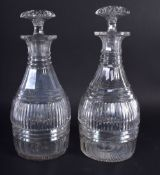 A PAIR OF GEORGE III CUT GLASS DECANTERS. 22 cm high.