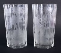 A PAIR OF BOHEMIAN ENGRAVED GLASSES decorated with birds and landscapes. 15 cm high.