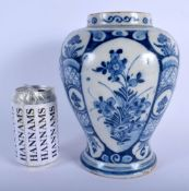 AN 18TH CENTURY DUTCH DELFT BLUE AND WHITE BALUSTER VASE painted with floral sprays. 23 cm x 12 cm.