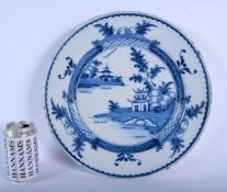 A LARGE 18TH CENTURY DUTCH DELFT BLUE AND WHITE CIRCULAR DISH painted with a hut upon an island. 32