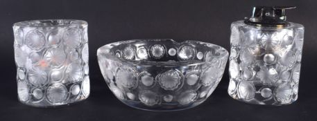 A FRENCH LALIQUE GLASS LIGHTER with matching ashtray and candle. Largest 10.5 cm diameter. (3)
